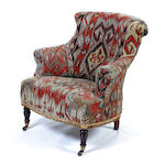 A Victorian carpet upholstered chair
