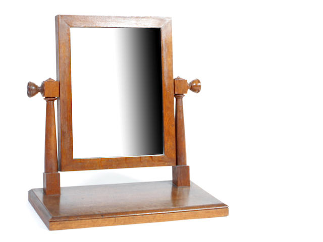 An Arts & Crafts oak dressing mirror