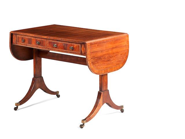 A Regency tulipwood sofa table