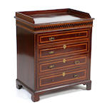 A mahogany and chequer banded bedside chest