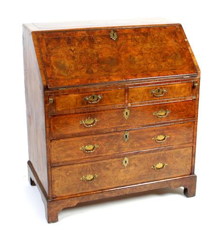A George II burr walnut bureau