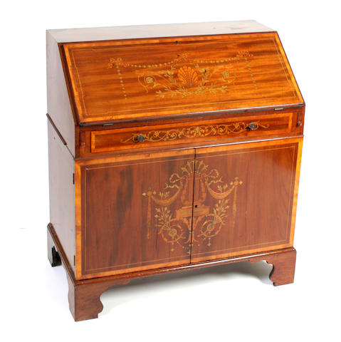 An Edwardian mahogany and inlaid bureau