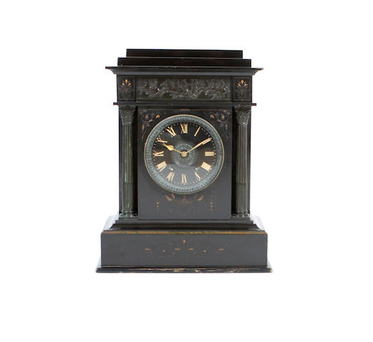 A large late Victorian black slate mantel clock