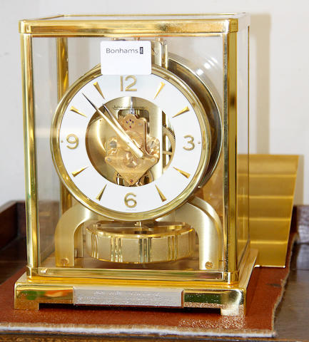 Jaeger-Le Coultre:  Atmos clock Caliber 526-5, brushed gilt brass case, 12cm, circular dial, scratch number 44159, together with original brushed gilt brass adjustable wall bracket.