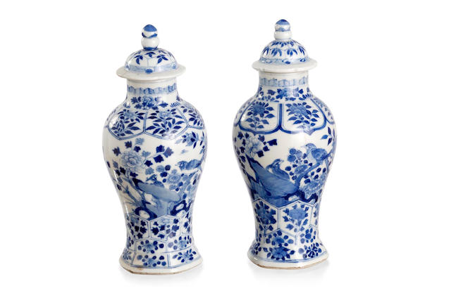 A pair of Chinese blue-and-white baluster vases and covers Six-character Kangxi mark to the base
