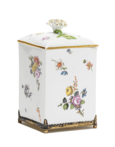 A Meissen tobacco box and cover with flower finial