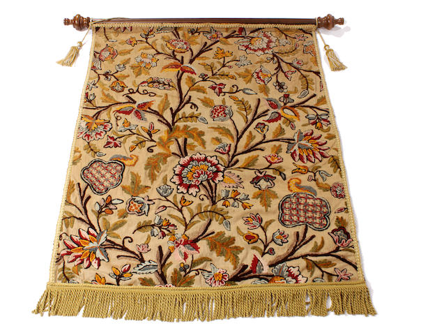 An early 20th century crewelwork wall hanging
