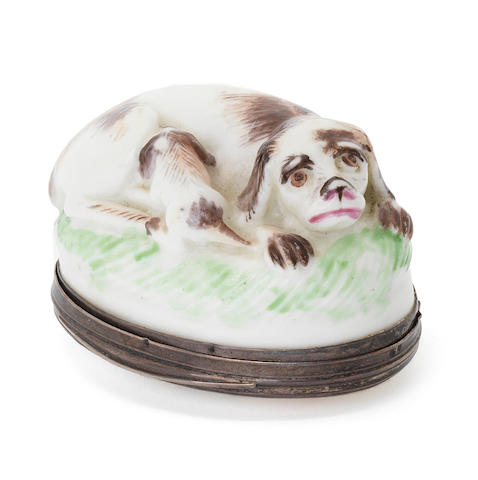 A Mennecy silver-mounted snuff box and cover, recumbent hound