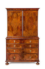 A William & Mary period  walnut and seaweed marquetry  cabinet on chestEnglish, late 17th century