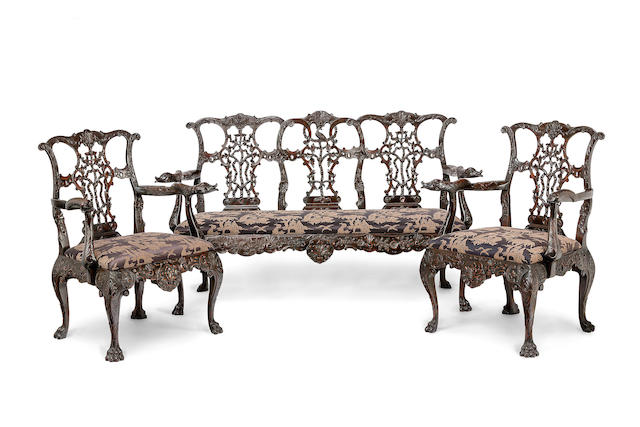 A fine Chippendale style mahogany suite, including a triple-chairback settee and two armchairsEnglish, 19th century