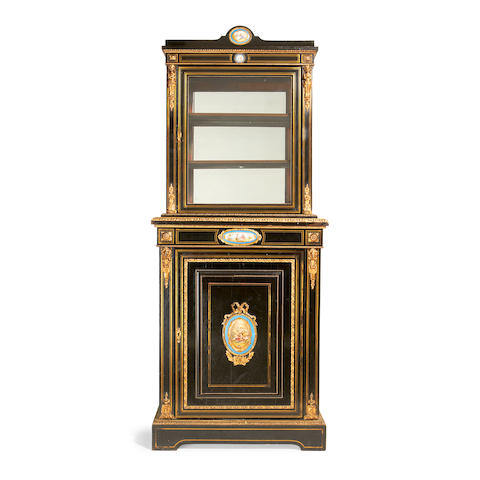 A French late 19th century porcelain and gilt metal mounted, brass line-inlaid, ebony and ebonised two-tier display cabinet in the Louis XVI style