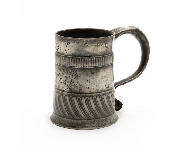 A rare gadrooned ale mug, ale pint capacity, circa 1703