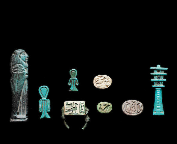 Eight Egyptian glazed composition and steatite scarabs, amulets and plaques 8