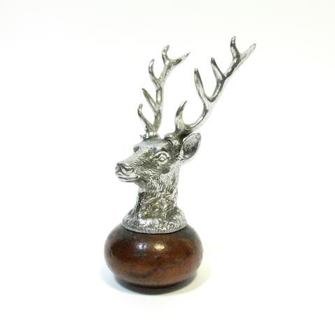 A stag head car mascot