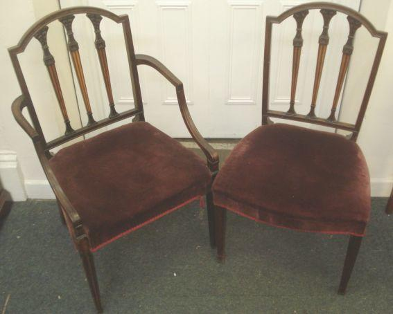 A George III style mahogany open elbow chair, in the Hepplewhite taste, moulded frames with leaf carved and inlaid upright splats on moulded square tapered legs, and three matching single chairs of an earlier period. (4)