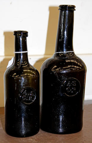 Two late 18th Century olive green wine bottles, both with applied seals for 'all Souls College Common Room, Oxford', 22cm & 27cm. (2)