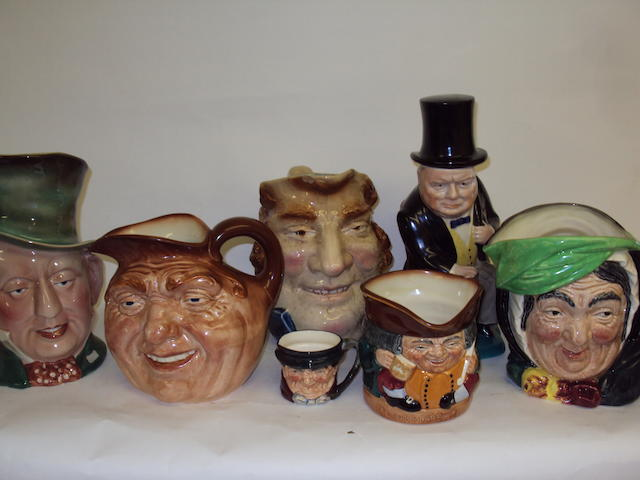 A collection of Royal Doulton and Beswick character jugs