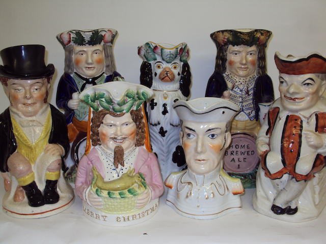 A collection of seven Staffordshire jugs