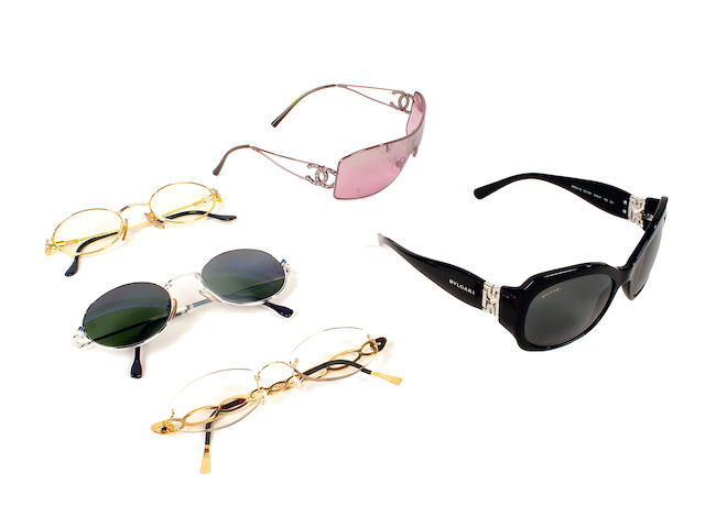 A group of designer sunglasses and reading glasses