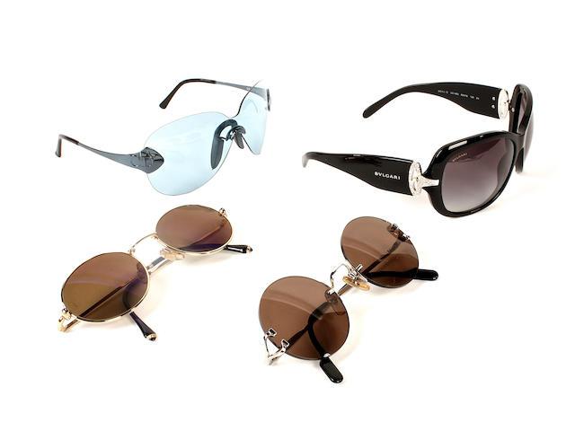 A group of designer sunglasses