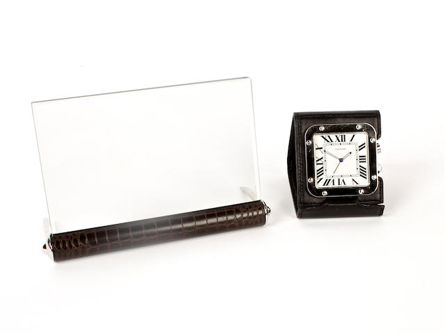 A Cartier photo frame and a Cartier travelling timepiece