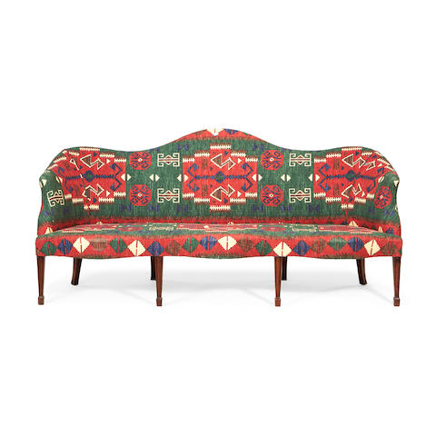 A Victorian mahogany serpentine sofa in the George III style