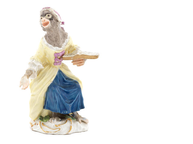 A Meissen monkeyband figure of a seated female singer third quarter 18th century (both hands and one foot restored) (Valuation Ref 305646/20)