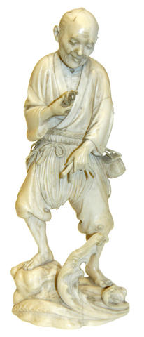 A Japanese ivory okimono of a fisherman, Meiji period