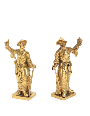 A pair of early 19th century gilt bronze standing Chinese figures