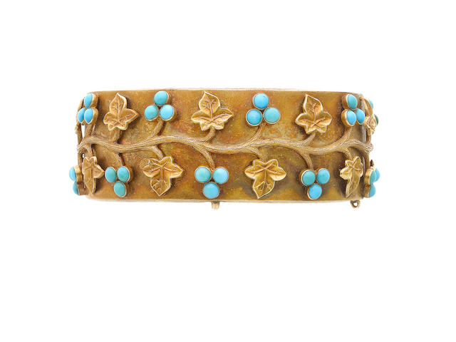 A mid 19th century gold and turquoise hinged bangle