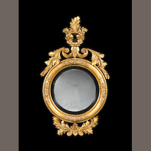 A small Regency carved giltwood and gesso convex mirror