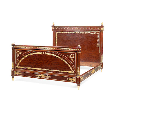 A French late 19th/early 20th century gilt metal mounted mahogany bed attributed to Francois Linke, in the Louis XVI style