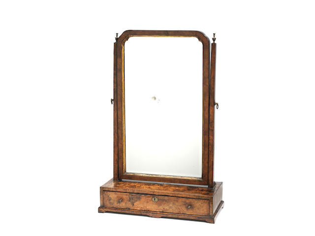 A George I walnut crossbanded, featherbanded and parcel gilt toilet mirror