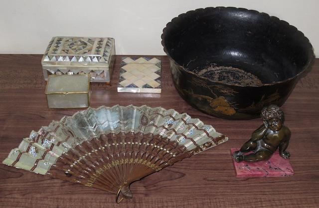 A papier mâchè bowl, two mother of pearl box's, mother of pearl card case, fan and a small bronze cherub,