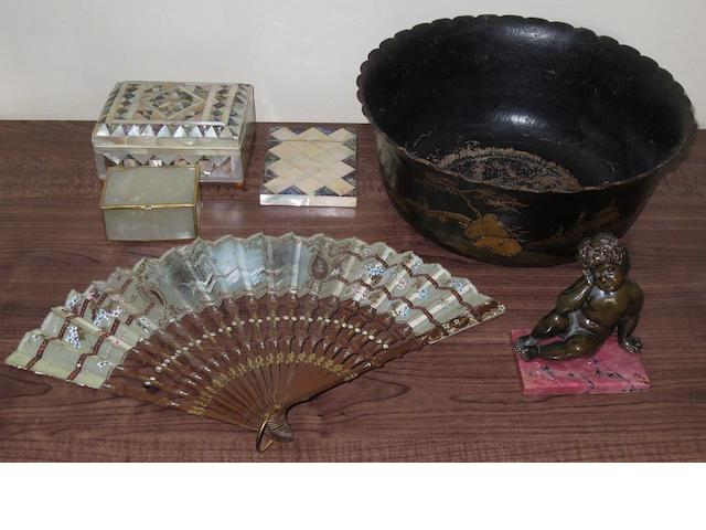 A papie machie bowl, two mother of pearl box's, mother of pearl card case, carved and painted fan and a small bronze cherub