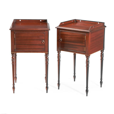 A pair of mahogany bedside cupboards in the Regency style