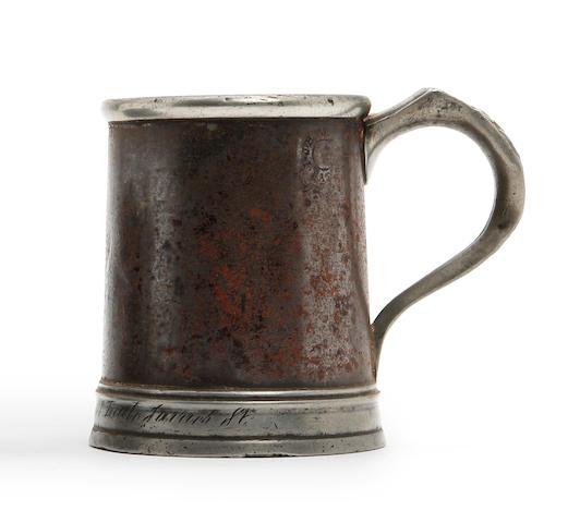 A pint straight-sided mug, circa 1870