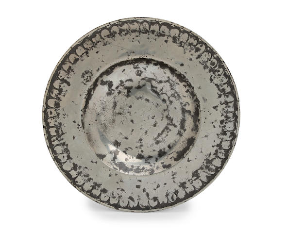 A fine and rare punch decorated broad rim dish, circa 1660