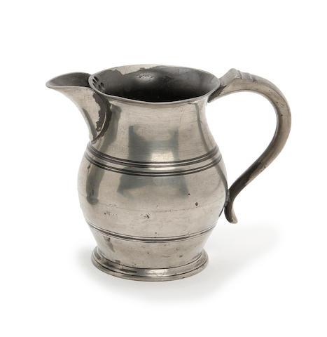 A pint spouted bulbous pewter ale jug, circa 1825