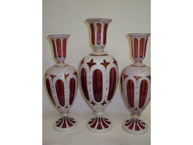 A garniture of Bohemian ruby flashed glass vases