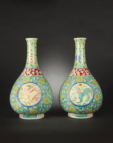 A pair of polychrome bottle vases