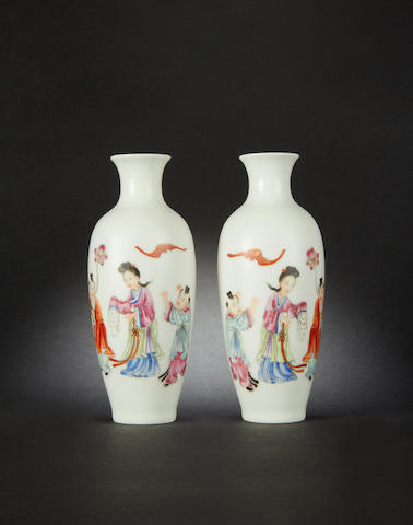 A small pair of famille rose vases Qianlong four-character marks