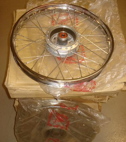 Eight n/o/s Honda wheels,