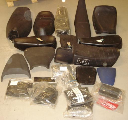 Assorted modern seats and saddles,
