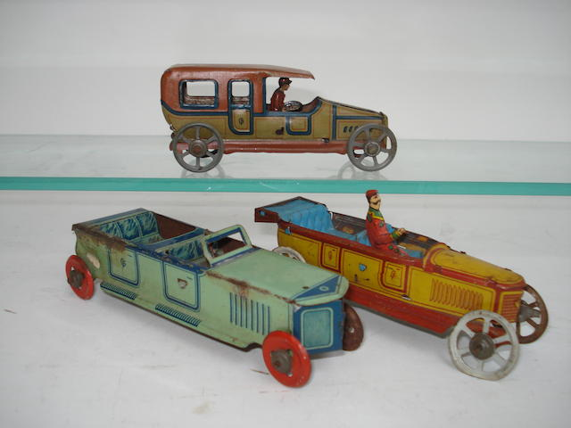 Three Georg Fischer penny toy Automobiles
