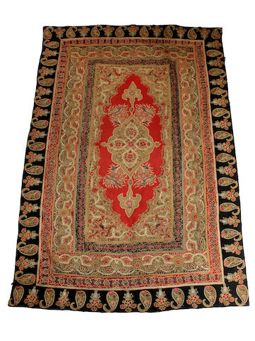 An Indian wall hanging and a woven rug