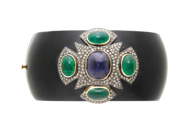 A bakelite, kyanite, emerald and diamond bangle (illustrated above)