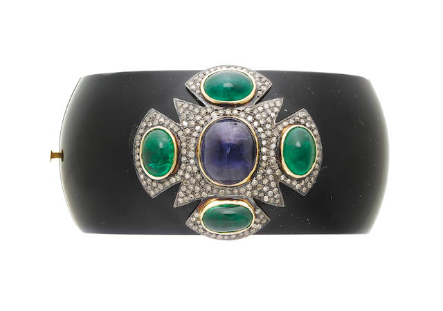 A bakelite, kyanite, emerald and diamond bangle (illustrated above)