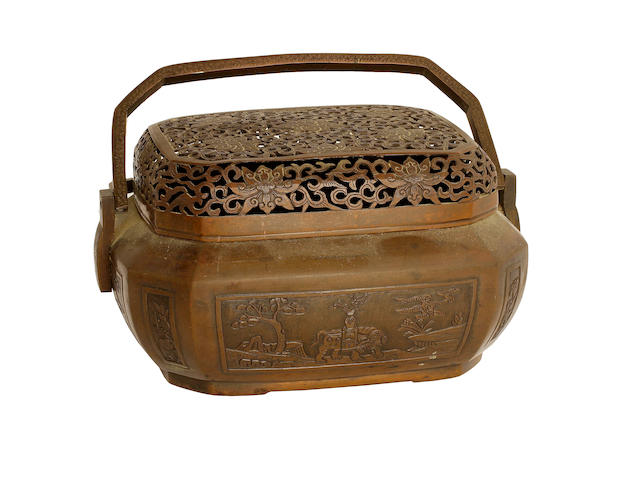 A Chinese two handled bronze hand warmer