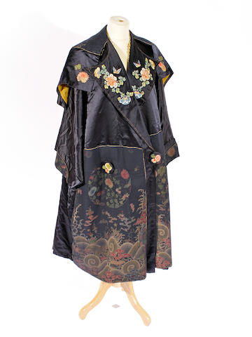 A circa 1915-1920 embroidered navy silk satin coat